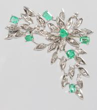 A LOVELY DIAMOND AND EMERALD SPRAY BROOCH set in white gold.