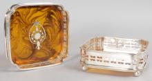 A PAIR OF SILVER PLATE AND FAUX TORTOISESHELL SQUARE WINE COASTERS, supported on four bun feet.  4.5ins square.