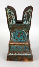 AN UNUSUAL SOUTH-EAST ASIAN ENAMELLED BRONZE STUPA BASE, possibly early, cast in relief with stylised figures reserved on pale blue and turquoise enamel grounds, 3.9in(9.9cm) square & 8in(20.3cm) high.
