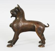 A PERSIAN QAJAR PERIOD ISLAMIC BRONZE MODEL OF A STANDING LION, standing four square, its body cast with Islamic script and formal panels, 6.8in(17.5cm) long & 6.3in(16cm) high.