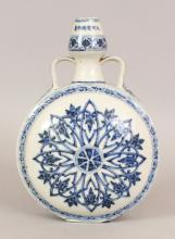 A GOOD CHINESE BLUE & WHITE PORCELAIN PILGRIM'S FLASK, of Middle Eastern inspired form and with genuine age wear, painted to one domed surface with ruyi and lappets radiating from a wheel medallion, the reverse side with lotus and lappets radiating from a yin-yang medallion, the neck with an extended six-character Xuande mark, 8in(20.3cm) wide at widest point & 11.5in (29.3cm) high.