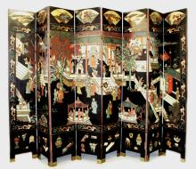 A VERY LARGE EARLY 20TH CENTURY CHINESE LACQUERED WOOD EIGHT FOLD SCREEN, carved and decorated to one side with an elaborate figural terrace scene above a precious objects border and beneath fan-form landscape panels, the screen reverse decorated with calligraphy and with animals and birds in a garden landscape setting, each fold 96.25in(244.5cm) high x 17.3in(44cm).
