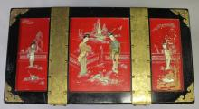 A CHINESE LACQUER CHEST with brass mounts and mounted with ivory figures. <br>3ft 4ins long.