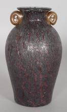 A GOOD LOETZ SPECKLED BLUE ROMAN SHAPED GLASS VASE with reddish handle. <br>6ins high.
