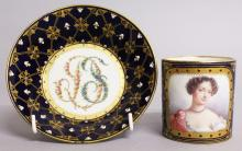 A GOOD 18TH CENTURY SEVRES CUP AND SAUCER with rich blue ground, the cup painted with a portrait of Melle de Fontange, the saucer with initials in flowers. <br>Sevres mark in blue initial K.  Bears Gold BADA label.