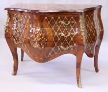 A LOUIS XVI STYLE KINGWOOD COMMODE, of bombe form, with marquetry inlay and ormolu mounts, the three long drawers supported on cabriole legs. <br>3ft 9ins wide x 2ft 10ins high x 1ft 10ins deep.