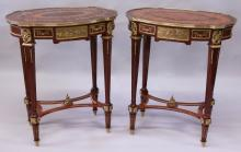 A PAIR OF LINKE STYLE KINGWOOD, MARQUETRY AND ORMOLU TABLES, of oval outline, the inlaid tops supported on tapering square legs united by a pierced under-tier. <br>2ft 2ins wide x 2ft 6ins high x 1ft 6ins deep.