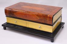 AN UNUSUAL ART DECO STYLE COFFEE TABLE, modelled as two large books, with two drawers to each side. <br>3ft 0ins long x 1ft 8ins wide x 1ft 5ins high.