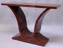 AN ART DECO STYLE ROSEWOOD CONSOLE TABLE, the rectangular top supported on curving sides with platform base. <br>4ft 0ins long x 2ft 9ins high x 1ft 4ins deep.