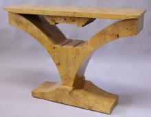 AN ART DECO STYLE BIRDSEYE MAPLE CONSOLE TABLE, the rectangular top supported on curving sides with a small drawer and platform base. <br>3ft 11ins long x 2ft 10ins high x 1ft 0ins deep.