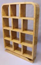 AN ART DECO STYLE BIRDSEYE MAPLE OPEN BOOK/DISPLAY SHELVES, with rounded top,