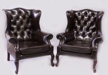A GOOD PAIR OF GEORGE III DESIGN LEATHER WING ARMCHAIRS, on carved cabriole legs.