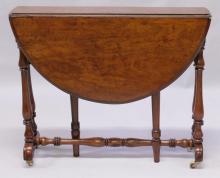 A VICTORIAN WALNUT SUTHERLAND TABLE.