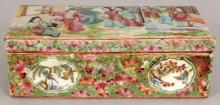 A 19TH CENTURY CHINESE CANTON RECTANGULAR PORCELAIN BRUSH BOX & COVER, the cover painted with a figural garden terrace scene, the base unglazed, 7.5in x 3.75in x 2.6in high.
