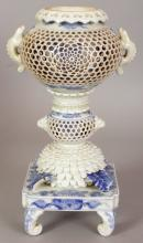 A JAPANESE MEIJI PERIOD HIRADO RETICULATED PORCELAIN KORO ON STAND, circa 1900, in two sections, each piece with pierced and reticulated lattice work, 8.1in high overall.
