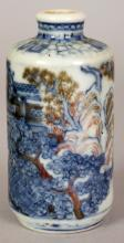 A 19TH/20TH CENTURY CHINESE UNDERGLAZE-BLUE & COPPER-RED PORCELAIN SNUFF BOTTLE, painted with a continuous figural landscape scene, the base with an unusual pagoda mark, 2.9in high.