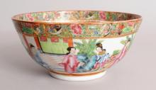 A GOOD QUALITY 19TH CENTURY CHINESE CANTON MANDARIN PORCELAIN BOWL, the sides painted with a continuous figural terrace and fenced garden scene, the interior with key-fret bordered figural panels, 5.6in diameter & 2.6in high.