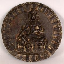 A 19TH/20TH CENTURY CHINESE CIRCULAR BRONZE PLAQUE, cast in high relief to its centre with Amitayus Buddha seated on a double lotus plinth, the rim of the plaque cast with a lotus border, 7in diameter.