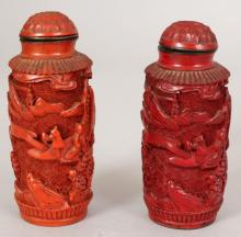 A PAIR OF 20TH CENTURY CHINESE RED CINNABAR LACQUER SNUFF BOTTLES & STOPPERS, each carved in deep relief with a continuous river landscape scene, 2.75in high overall.