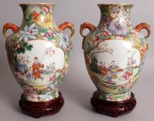 A FINE QUALITY MIRROR PAIR OF EARLY 20TH CENTURY CHINESE REPUBLIC PERIOD MILLEFLEUR PORCELAIN VASES, together with later fitted wood stands, each well painted with two quatrefoil panels of boys playing in garden settings, the panels reserved on a ground of dense overlapping flowerheads and leafage, each base with a Qianlong seal mark, each vase itself 9in high.