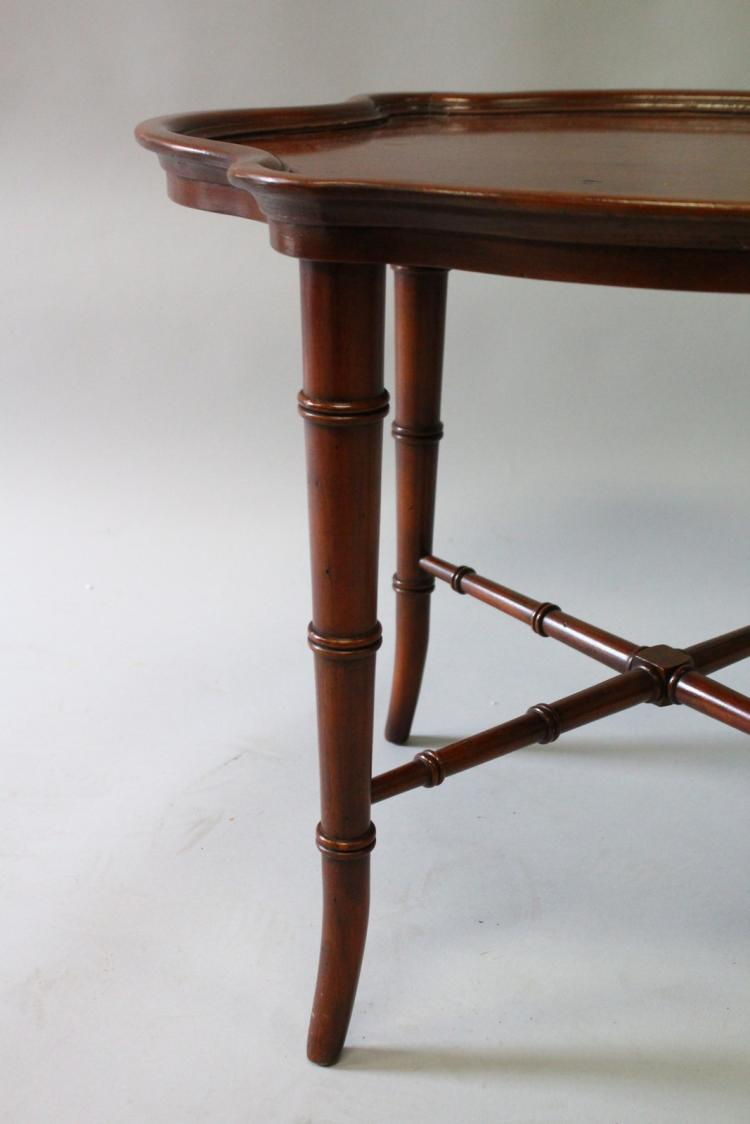 A Small Mahogany Shaped Top Coffee Table On Bamboo Type Legs