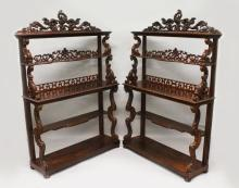 A SUPERB PAIR OF LATE REGENCY MAHOGANY STANDING OPEN BOOKCASES, with open backs three tiers with carved acanthus and scrolls 5ft 11in high x 4ft wide