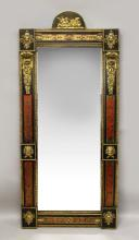 A VERY GOOD 18TH/19TH CENTURY TORTOISESHELL EBONY AND ORMOLU PIER MIRROR, in the manner of ANDRE-CHARLES BOULLE, the arch cresting applied with an ormolu mount depicting a classical female figure in a chariot being pulled by peacocks, the ebonised frame having fine tortoiseshell panels, a pair of leaf and scroll cast brackets and six raised ebonised panels with applied ormolu mask mounts. <br>5ft 7in high x 2ft 6in wide
