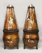 A GOOD PAIR OF 18TH CENTURY GERMAN OR NORTH ITALIAN MARQUETRY STANDING CORNER CABINETS, of tapering bombe form, each profusely inlaid with bone and marquetry depicting hunting figures on horse back, hounds at their feet, with an upper and lower door to each cabinet on square feet. 5ft 10in high x 2ft 4in wide