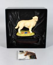 A ROYAL DOULTON PORCELAIN GOLDEN RETRIEVER, from the gun dog collection <br>6.5in long, in original box