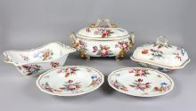 A GOOD BLOOR DERBY RED MARK PART DINNER SERVICE, CIRCA. 1820, Pattern No. 76, edged in gilt and painted with flowers, comprising large oval tureen and cover, 14ins long, square shaped tureen and cover, 10ins, boat shaped bowl, 13ins, pair of meat plates, 13ins, eight dinner plates, 10ins, seven soup plates, 10ins, all with gadrooned edges.