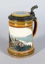 A GOOD METTLACH POTTERY TANKARD, decorated with a hillside view with river No: 2277 <br>5.5in high