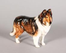 A ROYAL DOULTON COLLIE, H.N.1059. 3.5in high