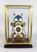 A GOOD SKELETON CLOCK, 20TH CENTURY, with moon phase movement in a glass case 1ft 8in high