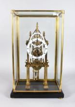 A GOOD CATHEDRAL STYLE SKELETON CLOCK, 20TH CENTURY, in a glass case, 1ft 9in high