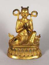 A GOOD GILDED BRONZE BUDDHA, hands clasped on a lotus base 7in high
