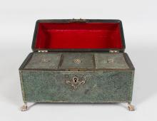 A RARE GEORGE III SHAGREEN THREE DIVISION TEA CADDY, with silver mounts and claw and ball feet. <br>10ins long.