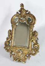 A GOOD ITALIAN CAST BRONZE EASEL MIRROR WITH MASK AND LION MOUNTS 21in high