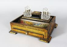 A GOOD VICTORIAN PAPIER MACHE TWO BOTTLE INK STAND, painted with flowers with a pen tray and a sliding drawer. 10.5in wide