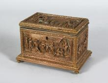 A 19th CENTURY CASSONE STYLE JEWELLERY BOX, stamped A.B. Paris in coppered bronze decorated in high relief with panels depicting 18th century rural scenes, hunting parties, dancing and drinking. <br>6in long x 4in high