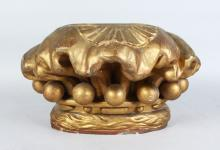 A LATE 19TH CENTURY CARVED AND GILDED WOOD PILLAR CAPITAL OR WALL BRACKET <br>1FT 2IN wide