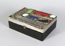 A JEWELLERY BOX, set with semi precious stones 9in long