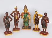 A GROUP OF FIVE INDIAN STUCCO CARVED WOOD AND PAINTED FIGURES.