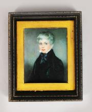 A MINIATURE OF A YOUNG BOY, with black cravat and coat 3.5in x 2.75in