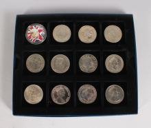 A CASE OF 12 SILVER CROWNS AND COMMONWEALTH CROWNS, including 1951 etc.