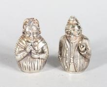 A GOOD PAIR OF SILVER PUNCH AND JUDY SALT AND PEPPERS