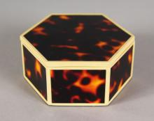 A FAUX TORTOISESHELL AND IVORY BANDED HEXAGONAL BOX AND COVER. <br>7.5cms.