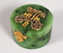 A RARE RUSSIAN FABERGE DESIGN GREEN JADE CIRCULAR BOX AND COVER with diamond set gold initials.  2.75ins diameter.