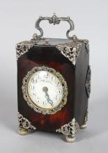 A GOOD CONTINENTAL TORTOISESHELL AND SILVER REPEATER CARRIAGE CLOCK, striking on a gong, with enamel dial, enamelled numerals, repousse pierced silver mounts, the dial signed CUENDET CONSTANT, BUDAPEST. <br>5ins high.