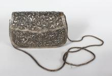 AN EASTERN WHITE METAL PURSE, with filigree decoration. <br>6ins wide.