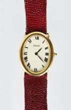 A PIAGET 18ct GOLD WATCH, with leather strap No: 9862/142944